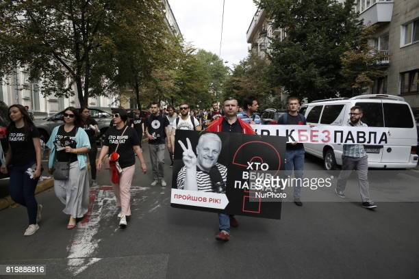 A few hundred activists and media representatives march downtown Kyiv Ukraine pass by the President Office and Internal Ministry from the site where...
