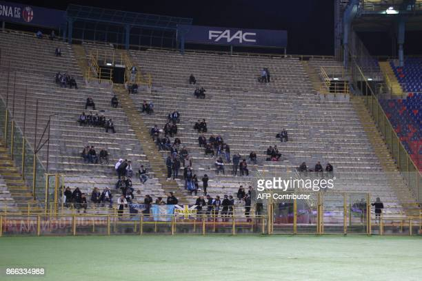 Few Lazio's supporters sit in the stands during the warm up prior the Italian Serie A football match Bologna vs Lazio on October 25 2017 at the...