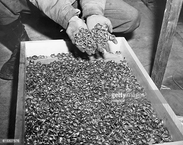A few of the thousands of wedding rings the Nazis removed from their victims to salvage the gold US troops found rings watches precious stones...