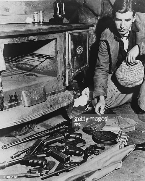 A few of the weapons used by American bank robber John Dillinger abandoned in the Little Bohemia resort near Mercer Wisconsin after the outlaw...