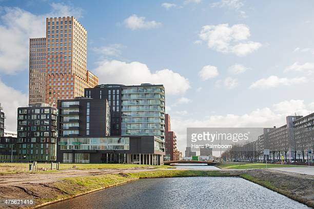 A few offices and appartments next to some water in the bussiness district of Amsterdam called Zuidas