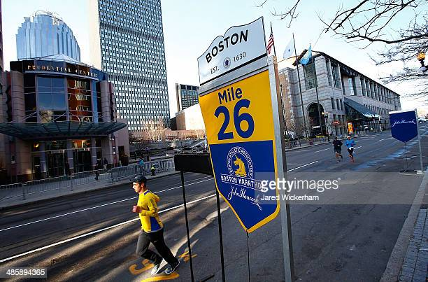 A few people run along Boylston Street near the 26 mile marker prior to the start of the 2014 BAA Boston Marathon on April 21 2014 in Boston...