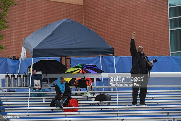 Few people sit in the stands for the championship game but Kareem AbdusSalaam cheers Bowie scores May 23 2016 in Upper Marlboro MD Bowie beat Eleanor...