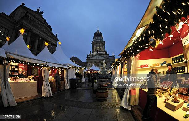 A few punters brave the rain to attend the opening day of the Christmas market at Gendarmenmarkt in Berlin November 22 2010 as the Christmas season...