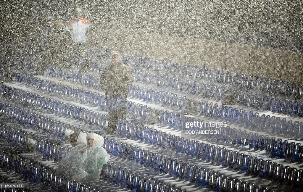 A few spectators brave the weather to watch the training run at the FIS Ski Jumping World Cup on the Muehlenkopfschanze hill in Willingen, western Germany on February 8, 2013. Heavy snowfall made the conditions challenging for the athletes.