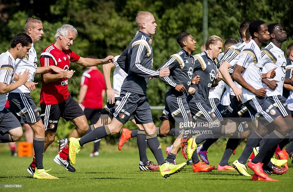 Feyenoord coach Fred Rutten (3eL) together with his team train in Rotterdam, The Netherlands, on August 27,2014. Feyenoord faces FC Zorya Luhansk for a UEFA Europa League play-offs return match on 28 August 2014. AFP PHOTO/ANP KOEN VAN WEEL netherlands out