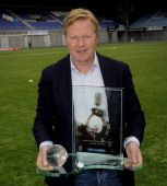 Feyenoord coach Ronald Koeman poses with the Rinus Michels Award for coach of the year 2011/2012 at the FC Zwolle Staion in Zwolle on May 18 2012...