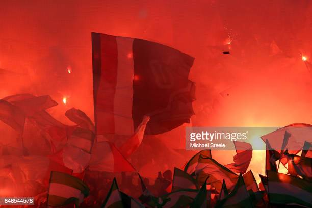 Feyenoord fans let off flares prior to the UEFA Champions League group F match between Feyenoord and Manchester City at Feijenoord Stadion on...