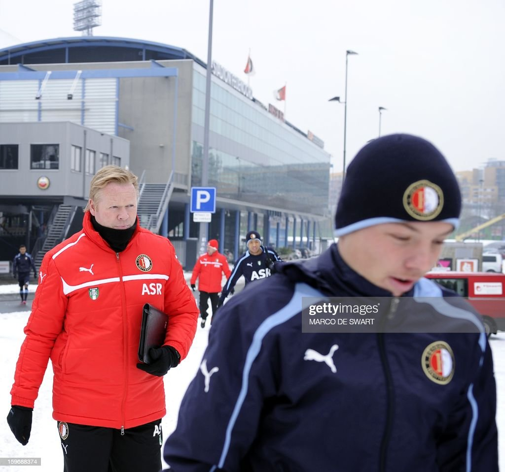 Feyenoord Rotterdam coach Ronald Koeman and Feyenoord player Jordy Clasie (R) are on their way to a training session on January 18, 2013 two days before their Eredivisie match against arch rival Ajax on January 20. AFP PHOTO / ANP - MARCO DE SWART = netherlands out