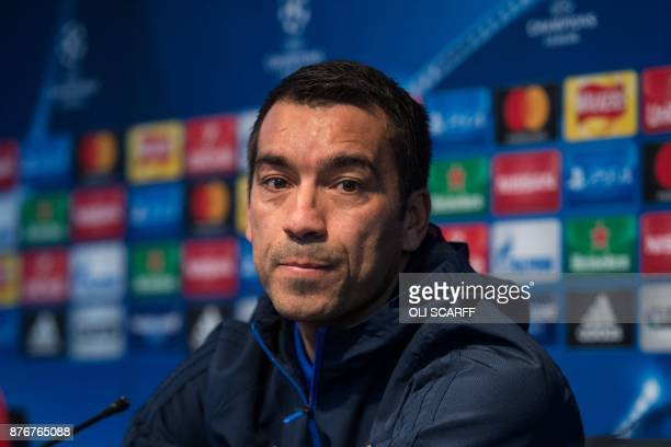 Feyenoord Rotterdam's Dutch manager Giovanni van Bronckhorst attends a press conference at the Etihad Stadium in Manchester northern England on...