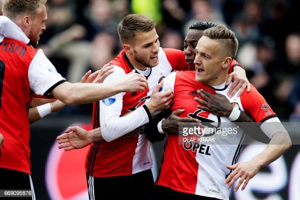 Feyenoord Rotterdam's Dutch midfielder Jens Toornstra celebrates with teammates Dutch defender Bart Nieuwkoop and Dutch midfielder Eljero Elia after...