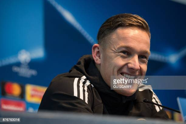 Feyenoord Rotterdam's Dutch midfielder Jens Toornstra talks to the media in a press conference at the Etihad Stadium in Manchester northern England...