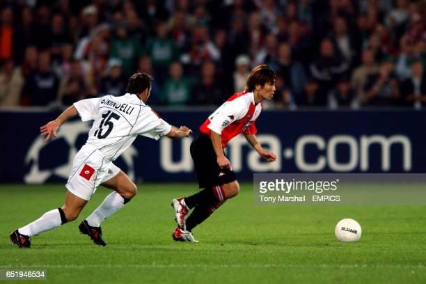 Feyenoord's ChongGug Song takes on Juventus' Alessandro Birindelli