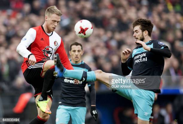 Feyenoord's Danish forward Nicolai Jorgensen and PSV's midfielder Davy Proepper go for the ball during the Dutch Eredivisie fottball match Feyenoord...