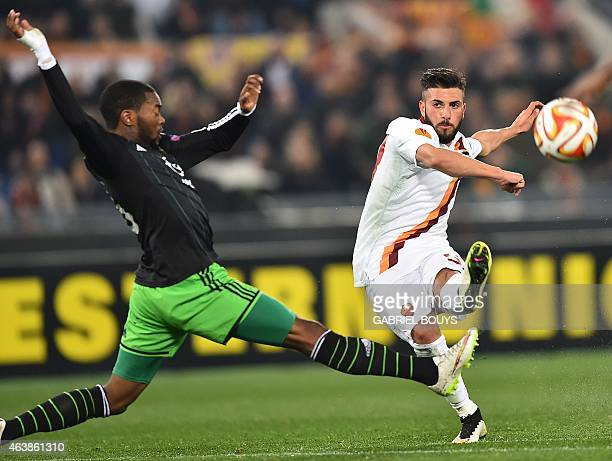 Feyenoord's defender Miquel Nelom vies with Roma's forward Daniele Verde during the UEFA Europa League round of 32 match AS Roma vs Feyenoord at the...