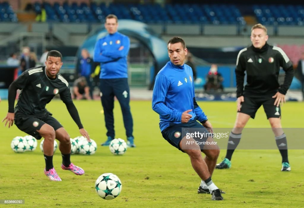 Feyenoord's Dutch coach Giovanni Van Bronckhorst (2nd-R) takes part in a training session on the eve of the UEFA Champions League Group F football match SSC Napoli vs Feyenoord Rotterdam at the San Paolo Stadium in Naples on September 25 2017. /