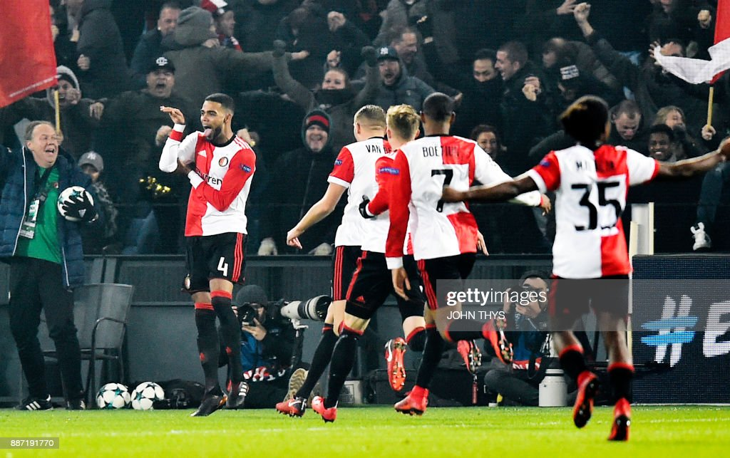 Feyenoord's Dutch defender Jeremiah St Juste (L) celebrates after scoring a goal during the UEFA Champions League Group F football match between Feyenoord Rotterdam and SSC Napoli at the Feyenoord Stadium in Rotterdam on December 6, 2017. /