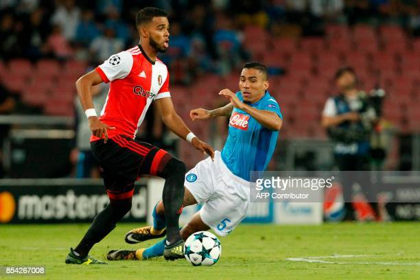 Feyenoord's Dutch defender Jeremiah St Juste fights for the ball with Napoli's midfielder from Brazil Allan during the UEFA Champion's League Group F...