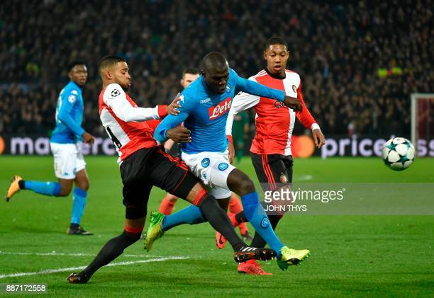 Feyenoord's Dutch defender Jeremiah St Juste vies for the ball with Napoli's defender from France Kalidou Koulibaly during the UEFA Champions League...
