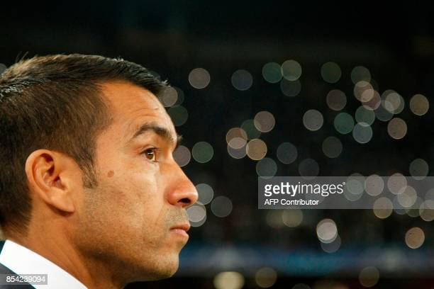 Feyenoord's Dutch head coach Giovanni Van Bronckhorst looks on before the UEFA Champion's League Group F football match Napoli vs Feyenoord Rotterdam...