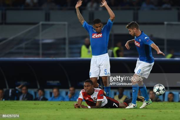 Feyenoord's Dutch striker JeanPaul Boetius is tackled by Napoli's midfielder from Brazil Allan and Napoli's midfielder from Brazil Jorginho during...