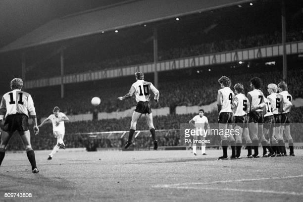 Feyenoord's Johan Cruyff attempts to block Glenn Hoddle's freekick