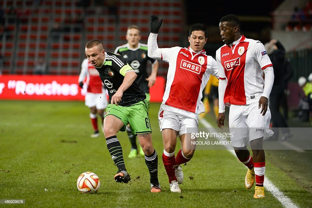 Feyenoord's midfielder Jordy Clasie vies with Standard's Yuji Ono and Standard's Geoffrey Mujangi Bia during their UEFA Europa League football match...