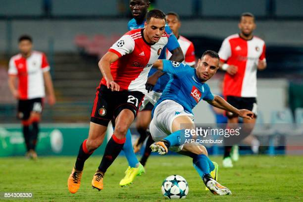 Feyenoord's Moroccan midfielder Sofyan Amrabat scores despite Napoli's midfielder from Serbia Nikola Maksimovic during the UEFA Champion's League...
