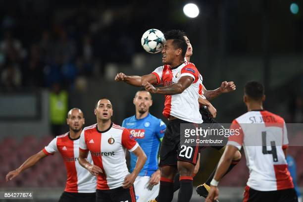 Feyenoord's Peruvian midfielder Renato Tapia heads the ball during the UEFA Champion's League Group F football match Napoli vs Feyenoord Rotterdam on...
