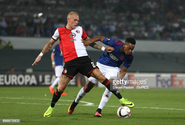 Feyenoord's Rick Karsdorp and Manchester United's Anthony Martial battle for the ball