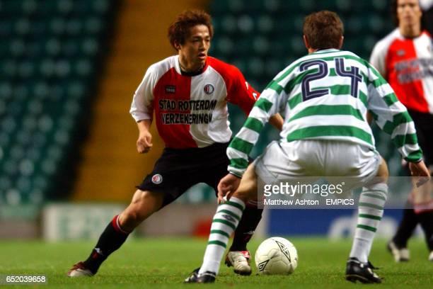 Feyenoord's Shinji One runs at the Celtic defence