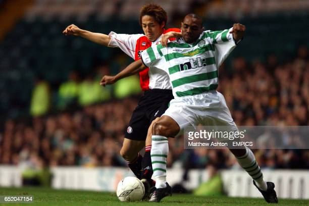 Feyenoord's Shinji Ono and Celtic's Didier Agathe battle for the ball