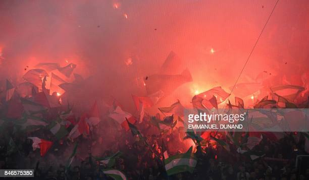 Feyenoord's supporters burns flares and wave flags during the UEFA Champions League Group F football match between Feyenoord Rotterdam and Manchester...