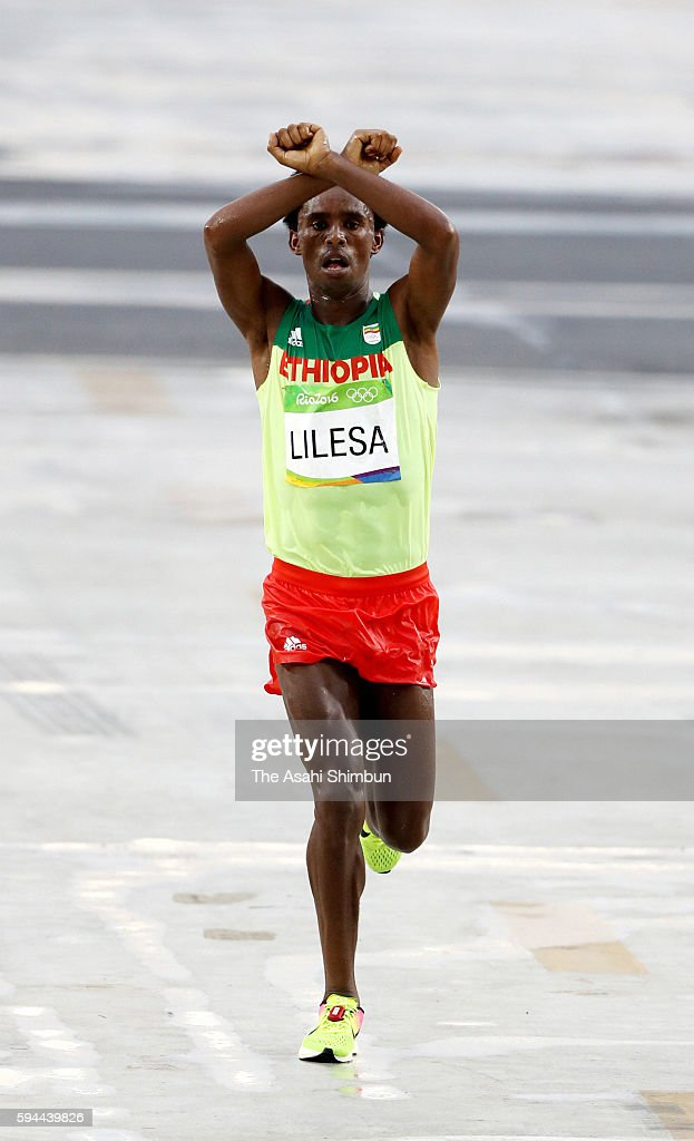 Feyisa Lilesa of Ethiopia crosses the line to win silver medal in the Men's Marathon on Day 16 of the Rio 2016 Olympic Games at Sambodromo on August 21, 2016 in Rio de Janeiro, Brazil.