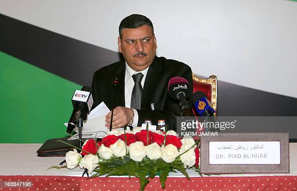 Fformer Syrian premier Riad Hijab chairs the first official meeting of the Free National Gathering's general assembly in Doha on March 8 2013 AFP...