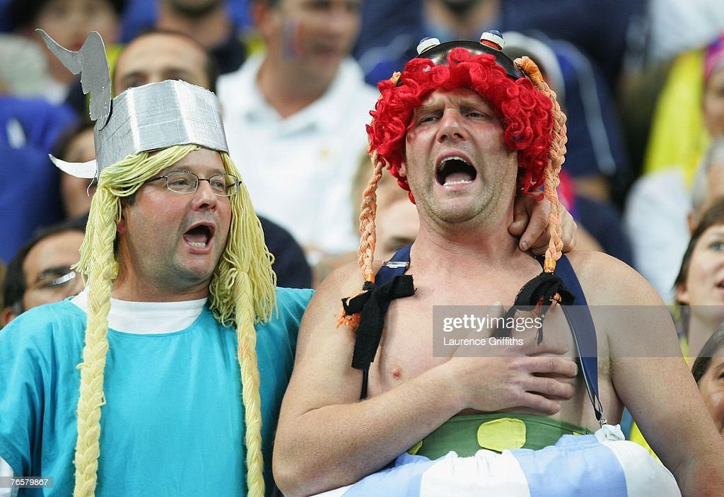 FFrench fans dressed as cartoon characters 'Asterix and Obelix' cheer on their team during the opening match of the Rugby World Cup 2007 between...