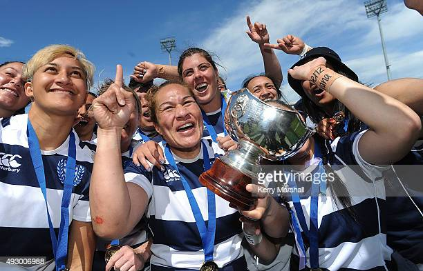 Fiaoo Faamausiliholds the Womens Provincial Cup as Auckland celebrate winning the final against Wellington at McLean Park on October 17 2015 in...