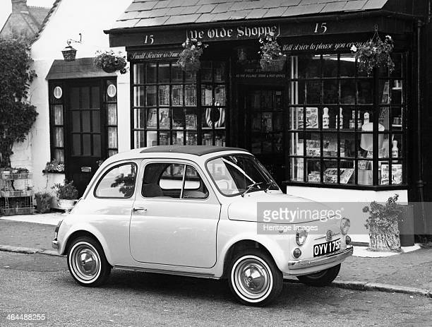 Fiat 500 parked outside a quaint shop 1969 Introduced in July 1957 the successor to the highly successful 'Topolino' the 'nuova 500' used a layout...