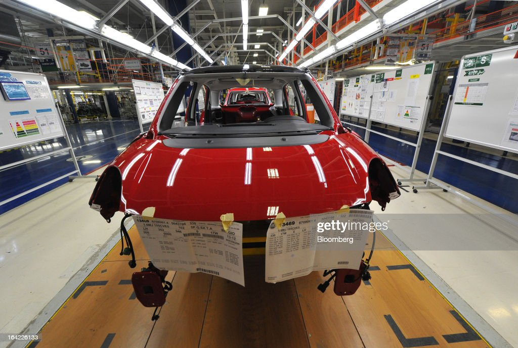 Fiat 500L automobiles stand on the production line during assembly at the Fiat Automobili Srbija plant in Kragujevac, Serbia, on Wednesday, March 20, 2013. Fiat Automobili Srbija, a joint venture between the government and Italian carmaker Fiat, is Serbia's sole automaker. Photographer: Oliver Bunic/Bloomberg via Getty Images