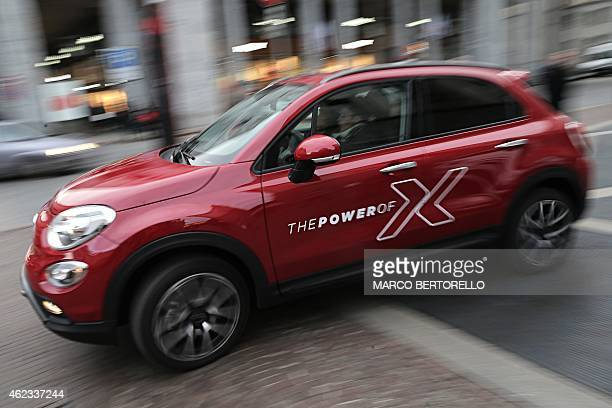 A Fiat 500X is pictured in piazza San Carlo on January 22 2015 in Turin FiatChrysler said on January 22 2015 it will add over 1000 new jobs at its...