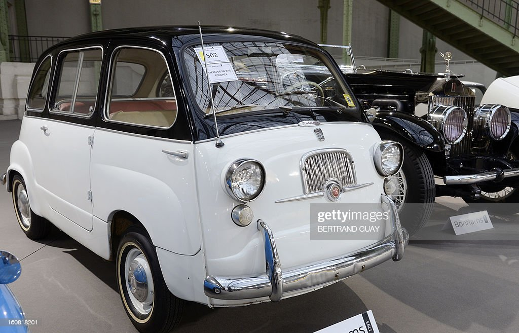 A Fiat 600 multipla from 1956 is displayed on February 6, 2013 at the Grand Palais in Paris on the eve of an auction of luxury vintage cars. 125 vintage motor cars, 100 collection motorbikes and a 1920's Gipsy Moth plane by De Havilland, will be auctionned at Bonhams on February 7. AFP PHOTO BERTRAND GUAY