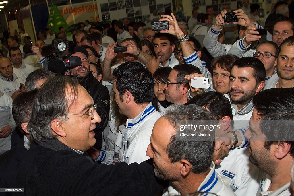 Fiat CEO <a gi-track='captionPersonalityLinkClicked' href=/galleries/search?phrase=Sergio+Marchionne&family=editorial&specificpeople=608333 ng-click='$event.stopPropagation()'>Sergio Marchionne</a> greets workers during a visit to the Fiat plant on December 20, 2012 in Melfi, Italy. The visit comes as the car maker's chief executive, <a gi-track='captionPersonalityLinkClicked' href=/galleries/search?phrase=Sergio+Marchionne&family=editorial&specificpeople=608333 ng-click='$event.stopPropagation()'>Sergio Marchionne</a>, announced plans to build new sport utility vehicles (SUV) at its Melfi plant by year-end.