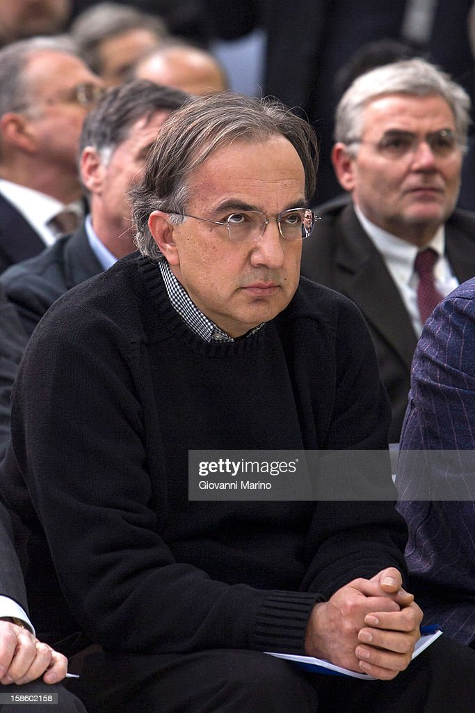 Fiat CEO Sergio Marchionne looks on as Italian Prime Minister Mario Monti visits the Fiat plant on December 20, 2012 in Melfi, Italy. The visit comes as the car maker's chief executive, Sergio Marchionne, announced plans to build new sport utility vehicles (SUV) at its Melfi plant by year-end.