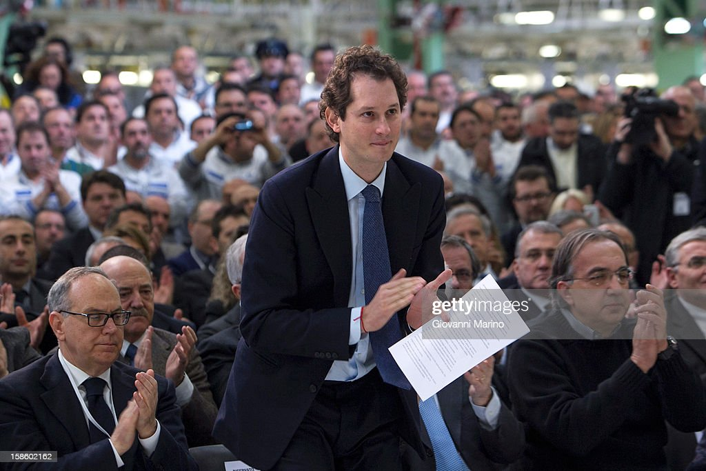 Fiat Chairman John Elkann applauds as Italian Prime Minister Mario Monti visits the Fiat plant on December 20, 2012 in Melfi, Italy. The visit comes as the car maker's chief executive, Sergio Marchionne, announced plans to build new sport utility vehicles (SUV) at its Melfi plant by year-end.