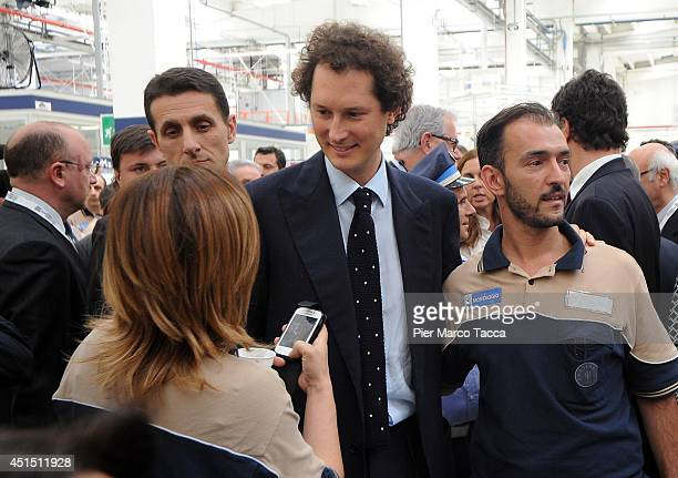 Fiat Chairman John Elkann greets workers during the visit of the Maserati Factory in Grugliasco dedicated to Gianni Agnelli on June 30 2014 in Turin...