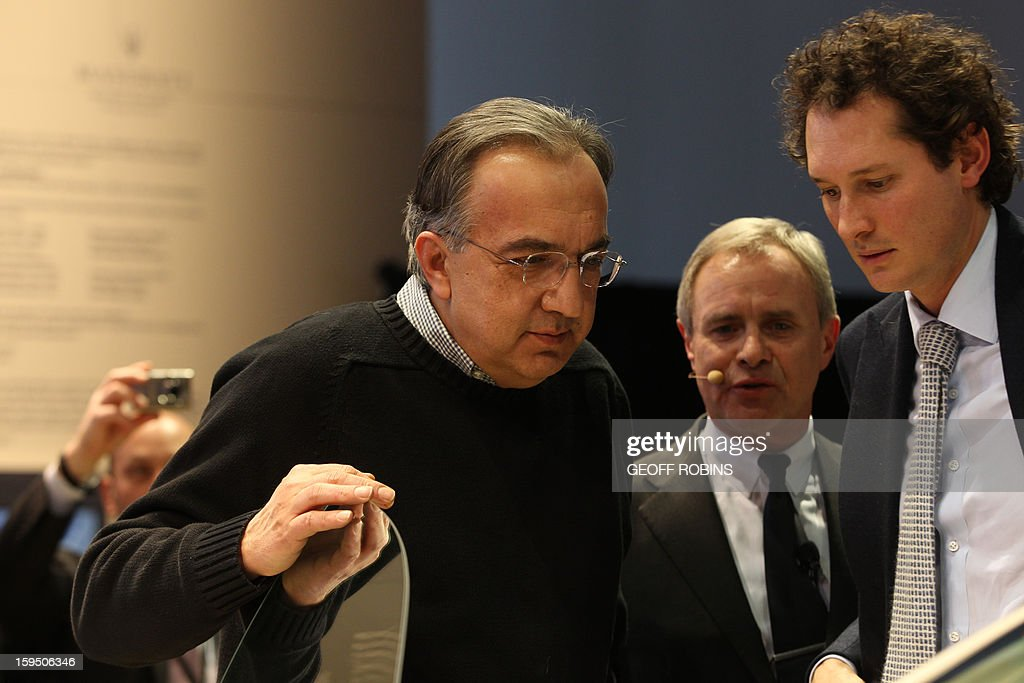 Fiat chairman John Elkann (R) , Maserati CEO Harald Wester (C) and Fiat CEO Sergio Marchionne look over the Maserati Quattroporte during its unveiling at the 2013 North American International Auto Show in Detroit, Michigan, on January 14, 2013. AFP PHOTO/Geoff Robins