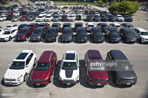 Fiat Chrysler Automobiles Jeep vehicles are displayed for sale at a car dealership in Moline Illinois US on Saturday July 1 2017 Ward's Automotive...