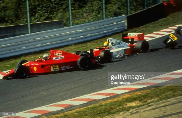 Fiat Ferrari driver Alain Prost of France and McLaren Honda driver Ayrton Senna of Brazil crash during the Japanese Grand Prix at the Suzuka circuit...