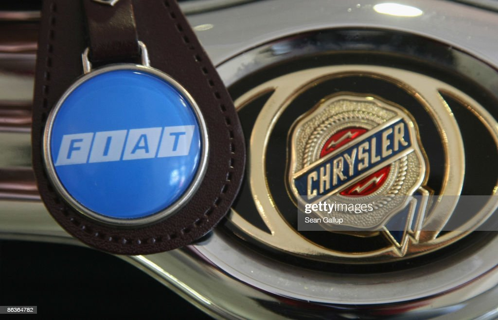 Fiat logo on a keychain dangles next to the hood ornament of a Chrysler car in this photo illustration on May 4 2009 in Berlin Germany According to...