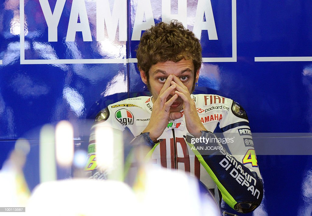 Fiat Yamaha team's rider Italian Valentino Rossi concentrates in the pits before his free practice session at Le Mans' circuit on May 21, 2010 two days ahead of the MotoGP French Grand Prix.